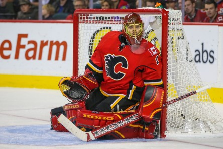 Nov 20, 2014; Calgary, Alberta, CAN; Calgary Flames goalie Jonas Hiller (1) guards his net against the Chicago Blackhawks during the second period at Scotiabank Saddledome. Chicago Blackhawks won 4-3. Mandatory Credit: Sergei Belski-USA TODAY Sports